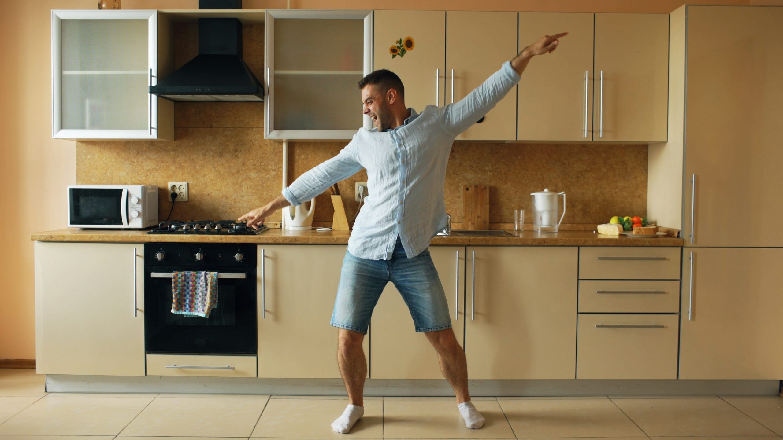 Man dancing in kitchen